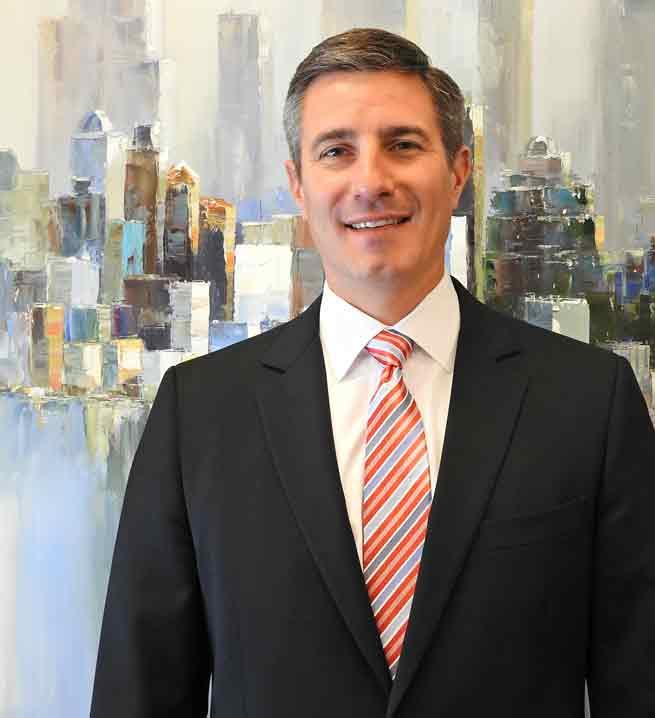 Headshot of Craig Coffman, Uptown Rental Properties Chief Financial Officer.