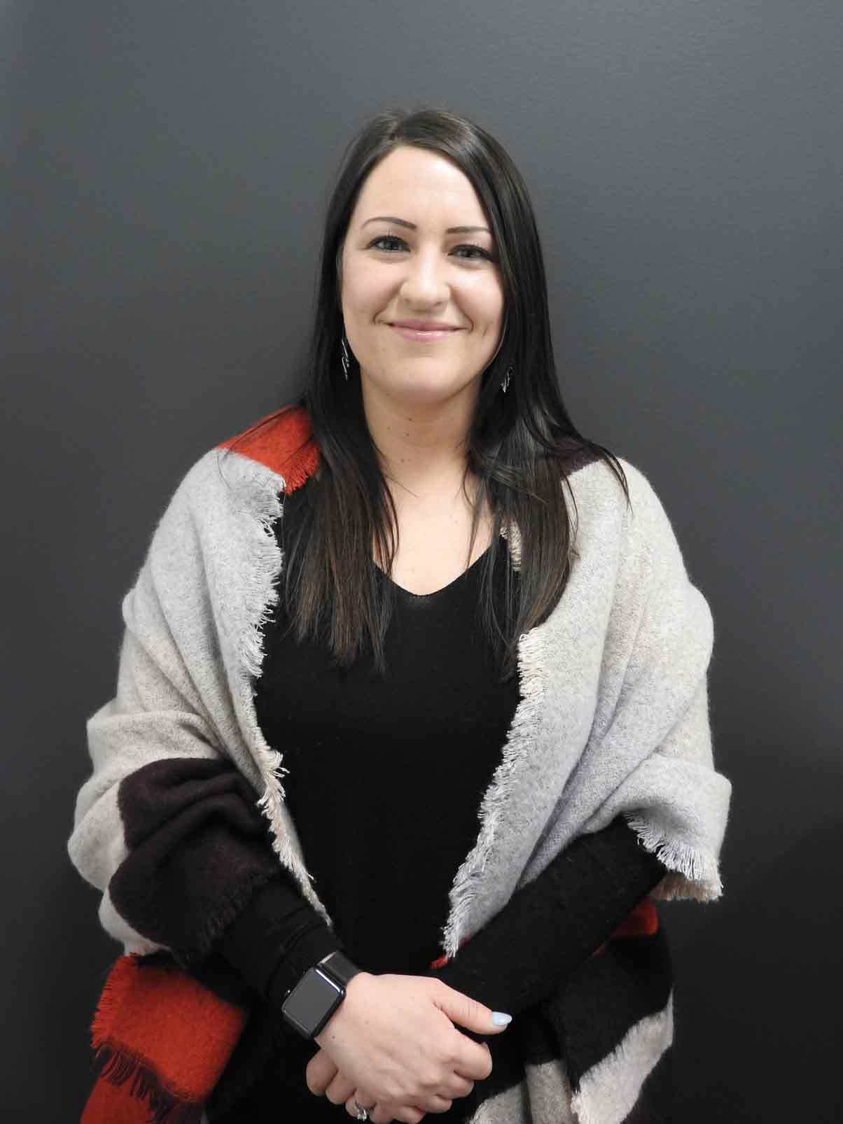 Headshot of Sarah Kitzmiller, Regional Property Manager at Uptown Rentals.