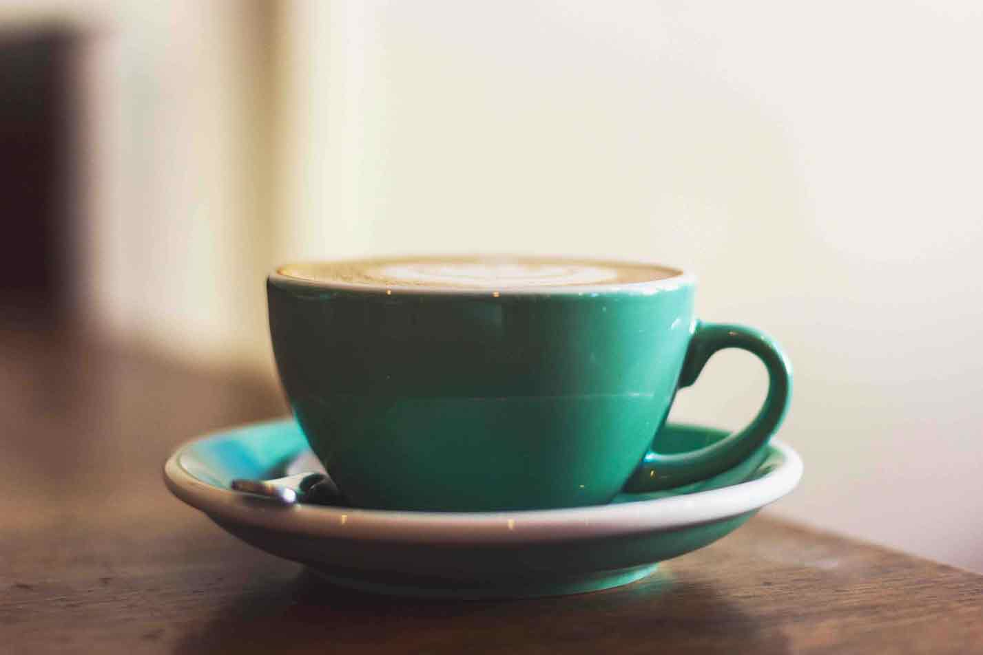 close up of green coffee cup